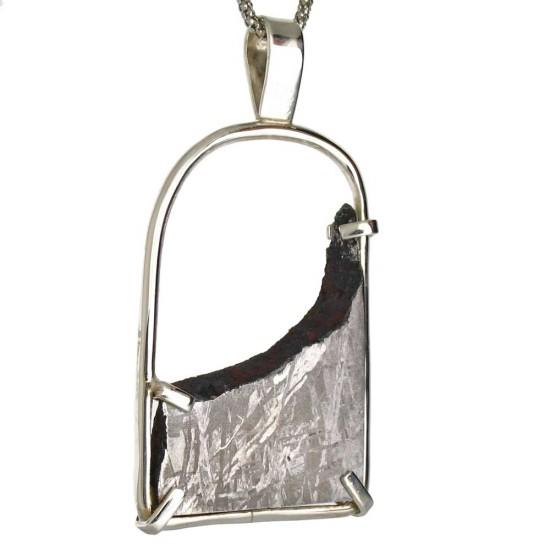 A Gibeon Meteorite Pendant in Silver Frame